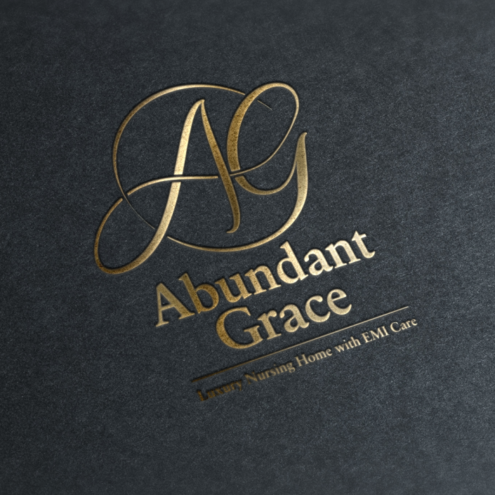 Abundant Grace logo in gold foil on black paper