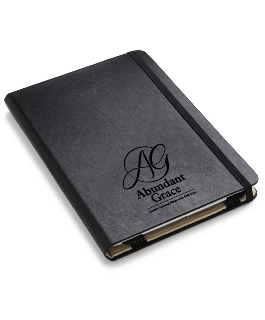 Abundant Grace logo on moleskin notebook